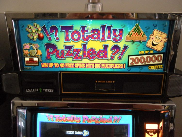 totally puzzled slot machine